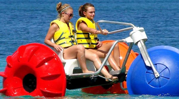 Aqua-Cycle™ Water Trikes with two girls peddling in the ocean