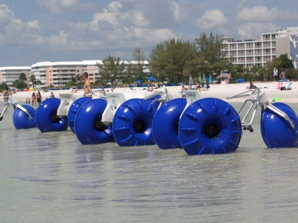 Four Aqua-Cycle™ Water Trikes renting on the beach by the hour at St. Petersburg Beach in Florida.