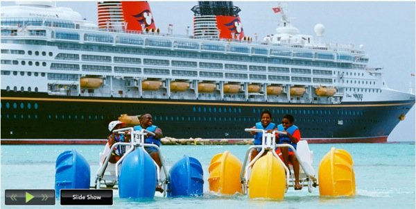 Two beach three wheeled pedal boats called Aqua-Cycles in use at a resort