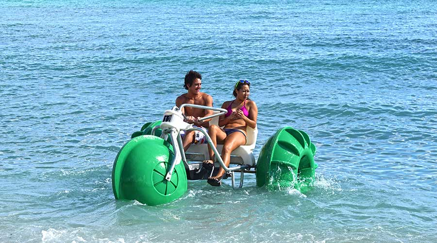 Having fun on a Aqua-Cycle water trike at a government retreat center