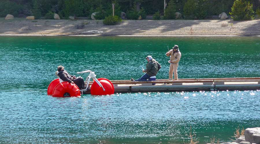 Guys drinking beer and having fun on a Aqua-Cycle water trike