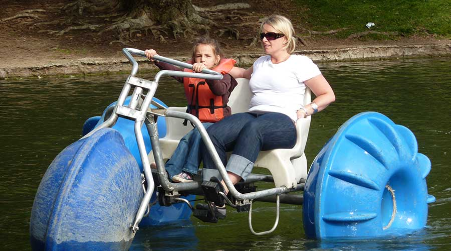 An Aqua-Cycle water trike rode by two happy people