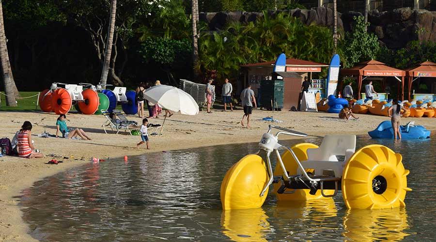 Three Aqua-Cycles ready for rent at an island resort beach rental business