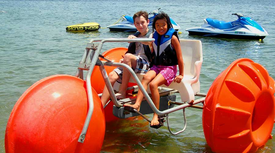 Orange Aqua-Cycle™ Water Trike at Campland on the Bay in San Diego for their recreation water equipment for a rental business