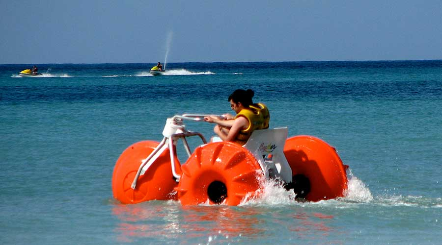 Orange Big Wheel Aqua cycle Water Trike at an Island Resort