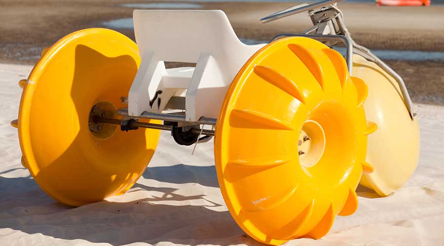 A yellow Aqua-Cycle™ Water Trike made in the USA built to last and ready for purchase.