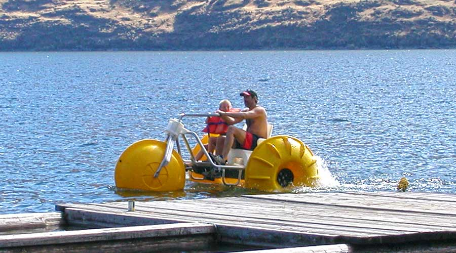 Aqua Cycle Water Tricycles at the dock of a lake