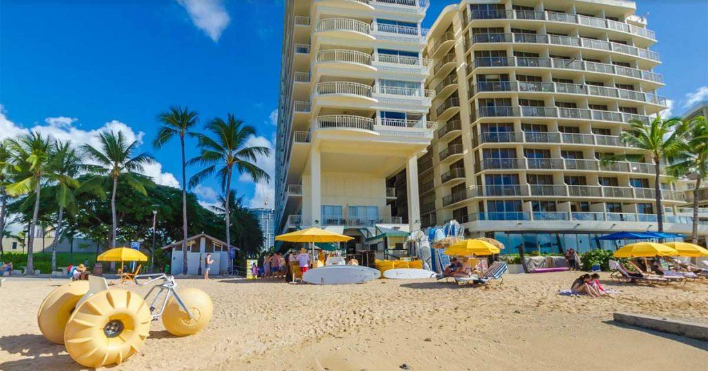 Waikiki Shore Beach Services winning with Aqua-Cycle Water Trikes below hotels on beach.