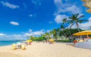 3 big paddle wheeled pedal bikes at Waikiki Beach in Hawaii